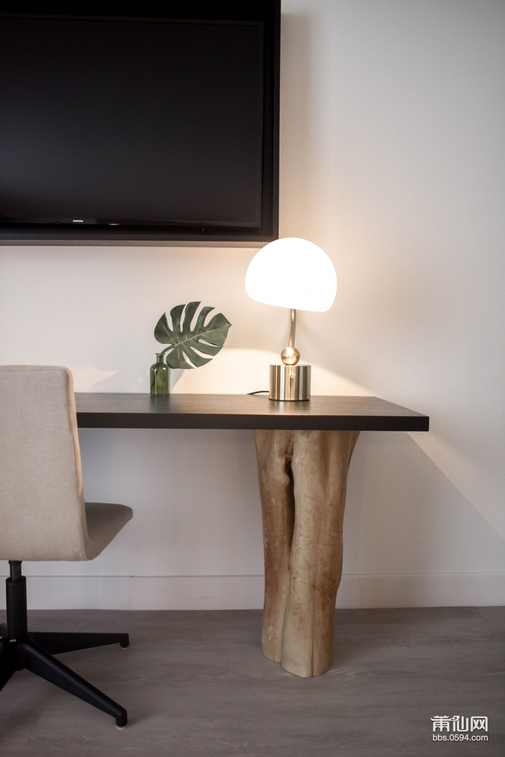 stainless-steel-base-white-shade-table-lamp-on-brown-wooden-1125137.jpg